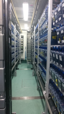 Rack of zebrafish tanks being fed by a robot feeder. Image taken at King's College London