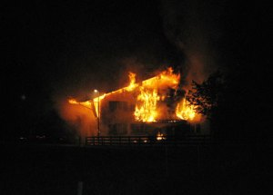 A Novartis executive has his house burned down by the Animal Liberation Front in August 2009