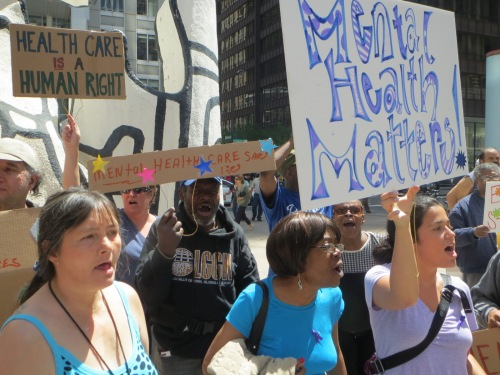 Health care providers and patients rally in support of mental health services